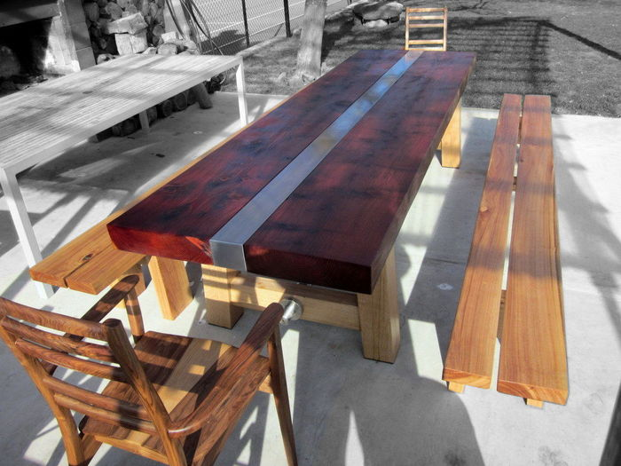 Redwood outdoor table. Top with s/steel insert, eucalyptus base and forms, walnut carver chairs